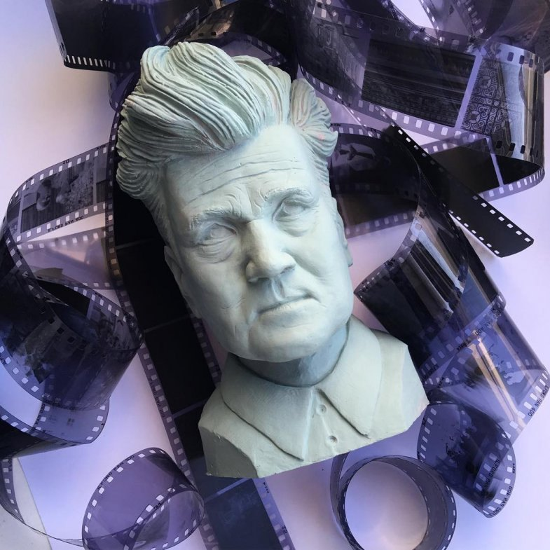 David Lynch bust with film rolls