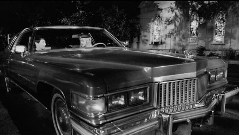 Kyle MacLachlan and Laura Dern inside a car