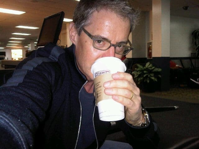 Kyle MacLachlan drinking coffee