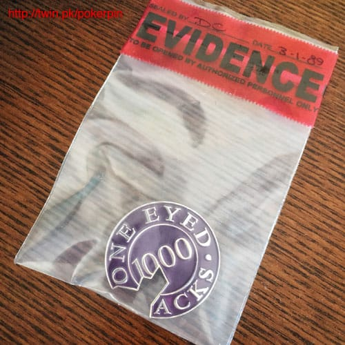 One Eyed Jacks poker chip pin in an evidence bag