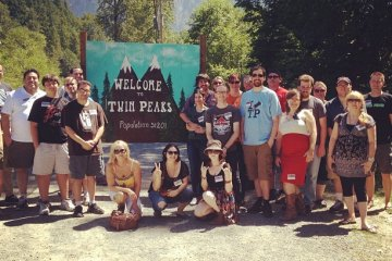 Group shot in front of the Welcome to Twin Peaks sign